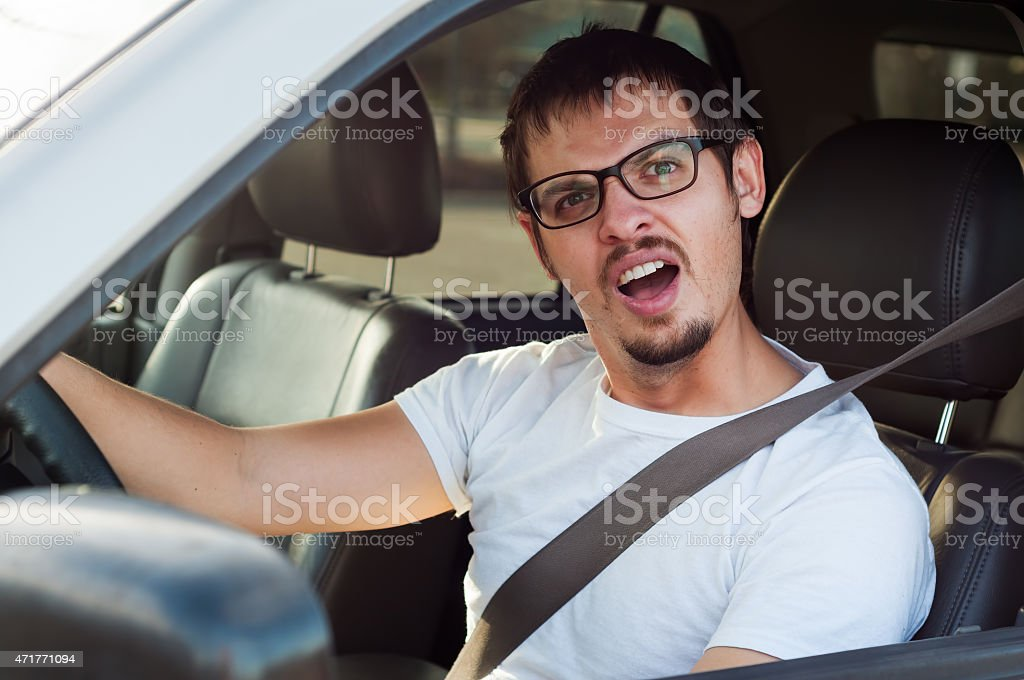 Male stupid face european driver is opening his mouth stock photo