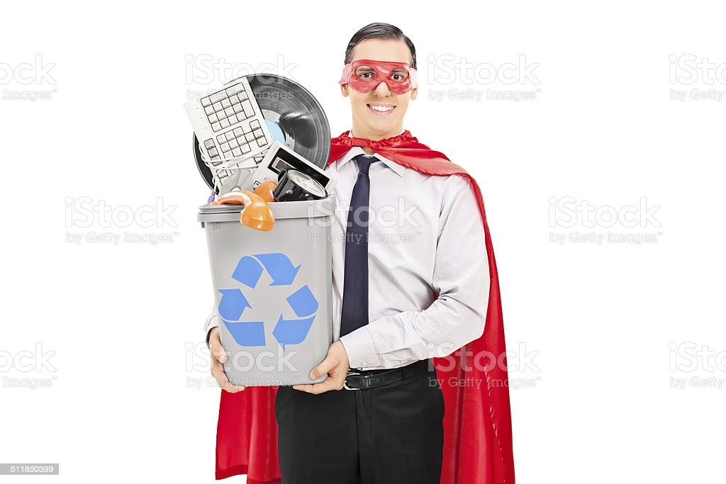 Male superhero recycling his old stuff stock photo