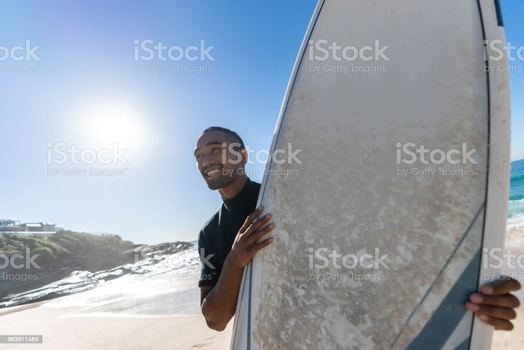Male surfer at the beach looking very happy - Royalty-free Adult Stock Photo