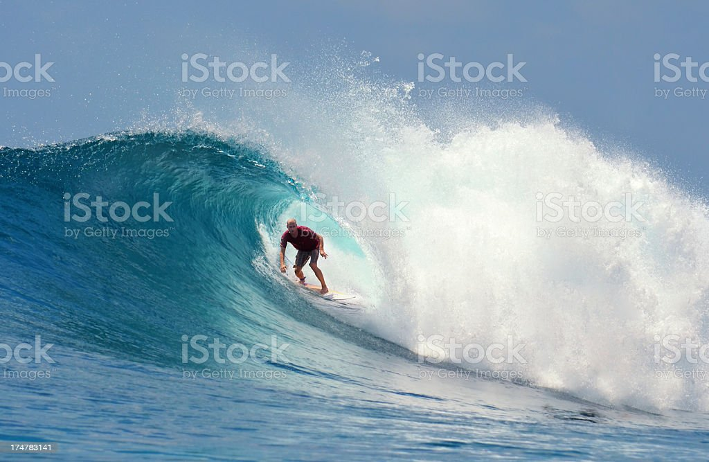 Male surfer in a wave curl riding a large wave stock photo