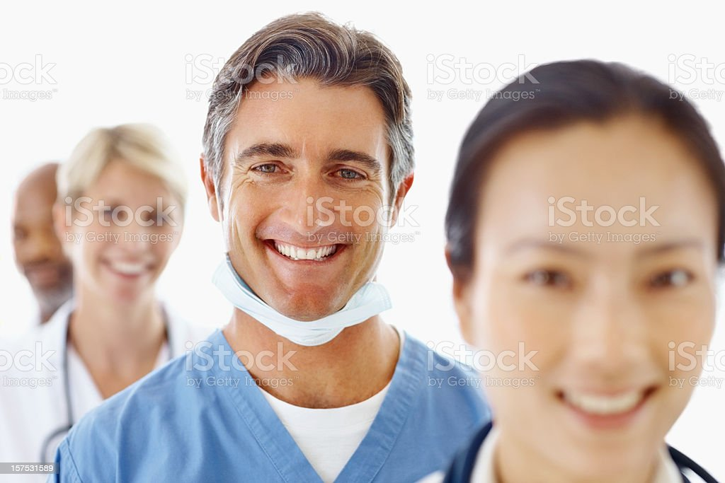 Male surgeon smiling between colleagues royalty-free stock photo