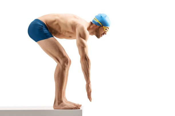male swimmer getting ready to start swimming - jump pool, swimmer imagens e fotografias de stock