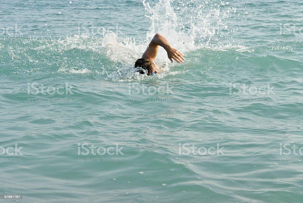 male swimmer swimming front crawl royalty-free stock photo