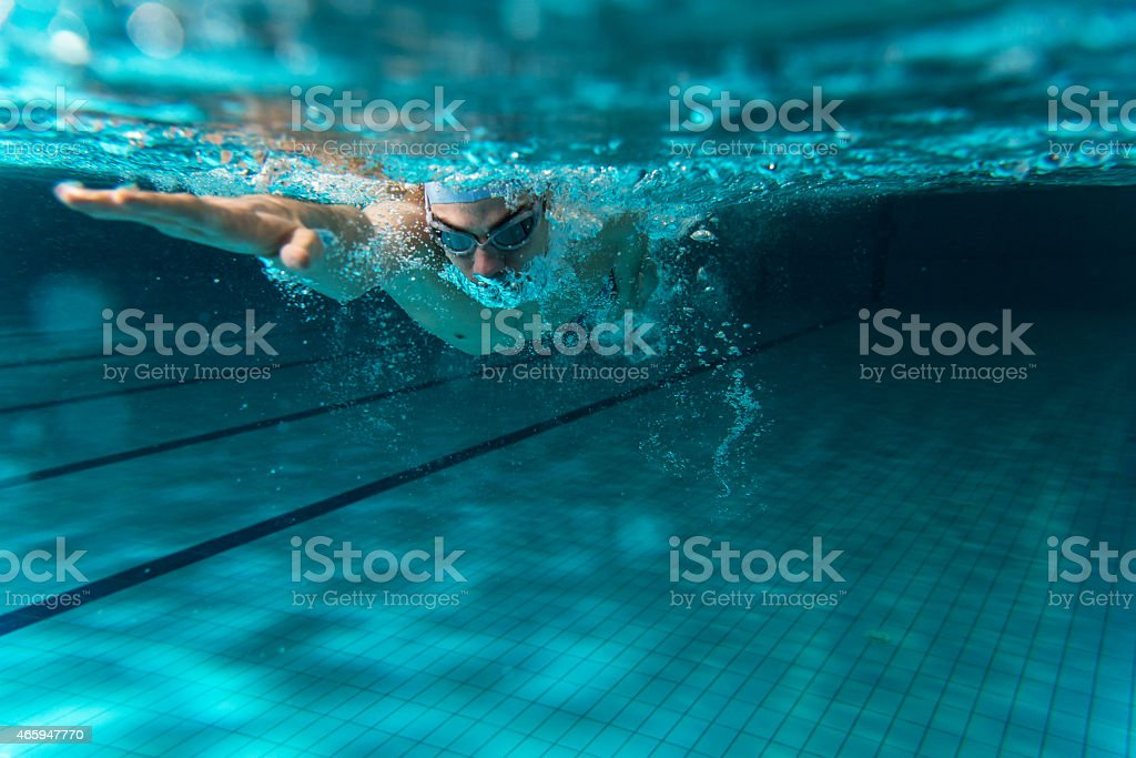 Male swimmer swimming underwater in a pool stock photo