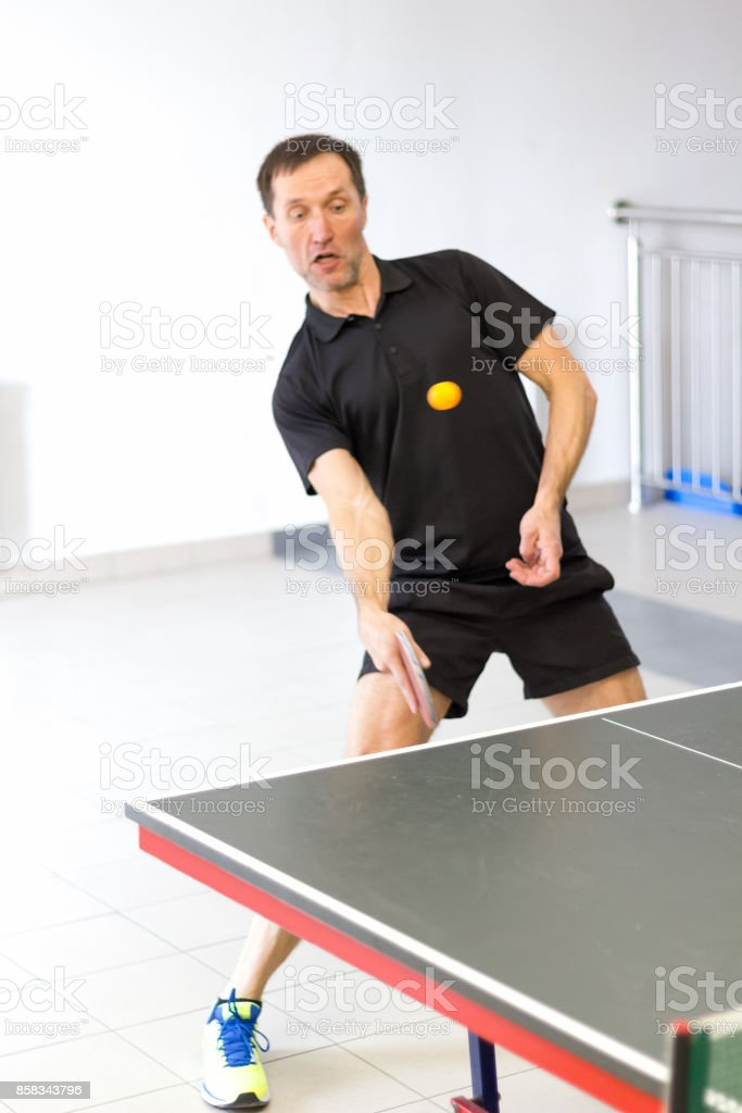 Male table tennis player playing forehand chop stock photo