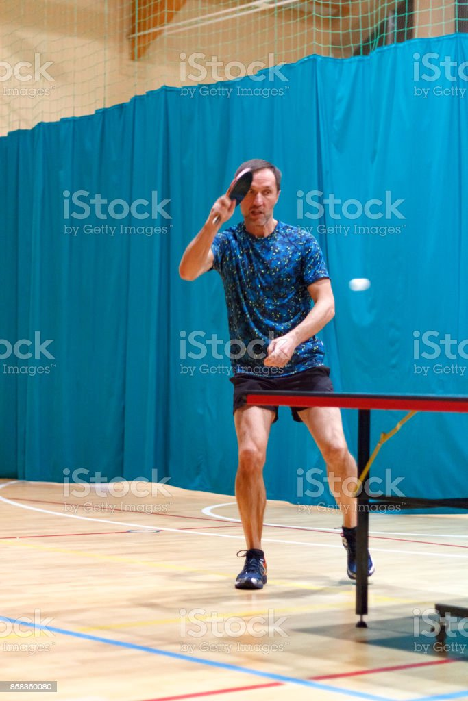 Male table tennis player playing forehand topspin stock photo