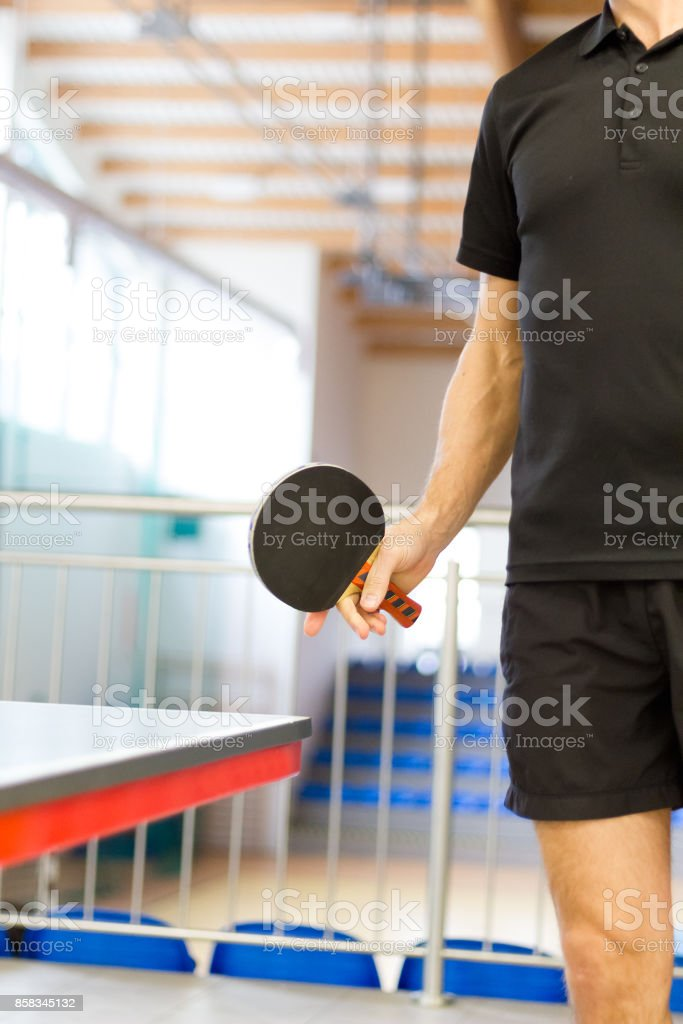 Male table tennis player preparing to play