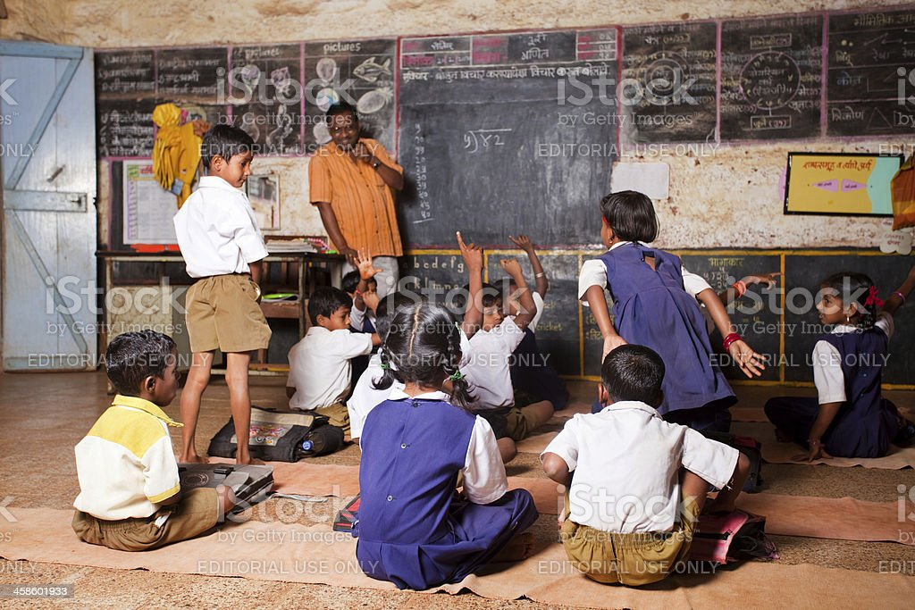 Male Teacher teaching students in a Rural School of India royalty-free stock photo