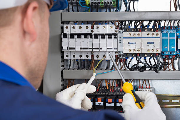 male technician checking fusebox - fuse box stock photos and pictures