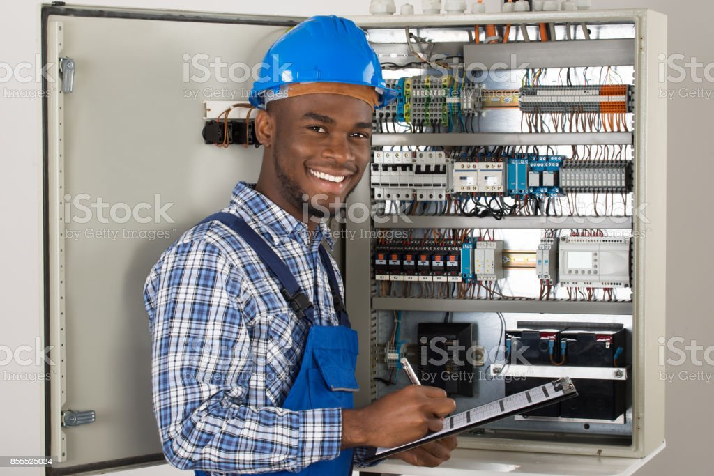 Male Technician Holding Clipboard stock photo