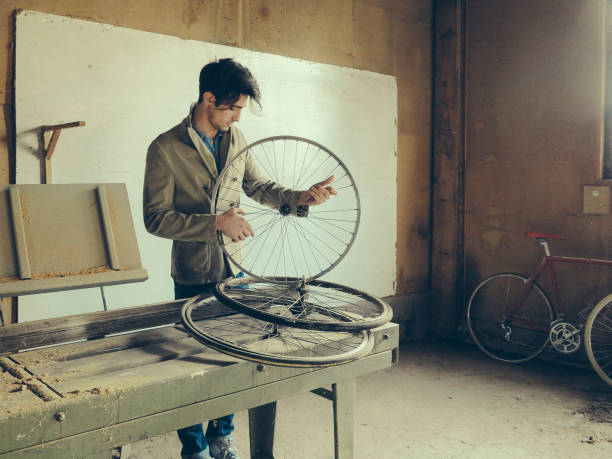 male technician in her bicycle repair shop stock photo
