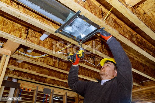 895571294 istock photo Male technician mounted air conditioner on ceiling ventilation s 1223675975