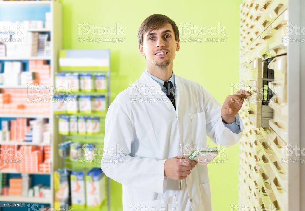 Male technician working in pharmacy depot stock photo