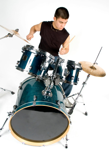 Male Teenager Playing Drum Set Isolated One White Background Stock Photo - Download Image Now