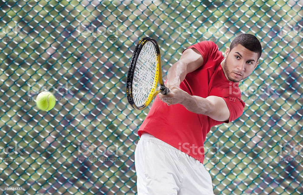 Male Tennis Player in Action stock photo