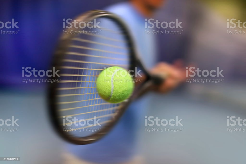 .male tennis player in action stock photo