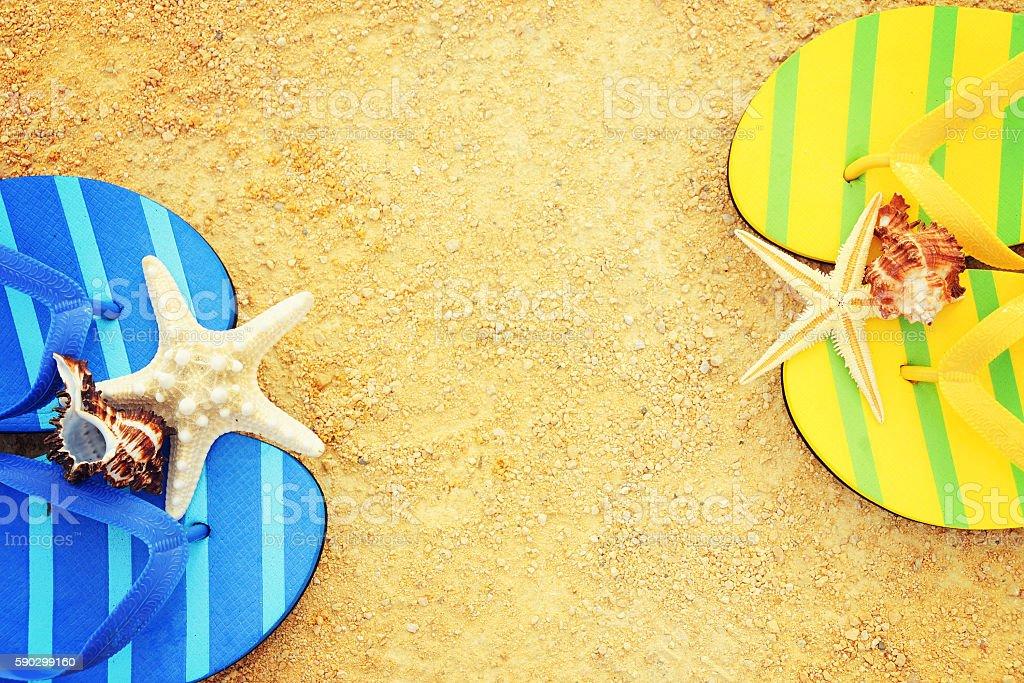 Male thongs on the sand beach with sea  background royaltyfri bildbanksbilder