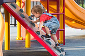 Male Caucasian Toddler Playing climbing at the playground