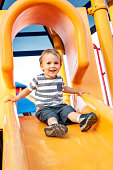 Caucasian Male toddler playing at the playground