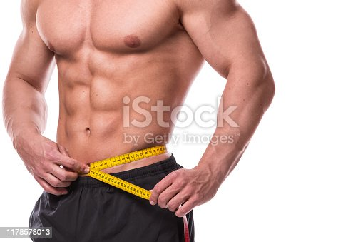 Male torso and measuring tape on white background