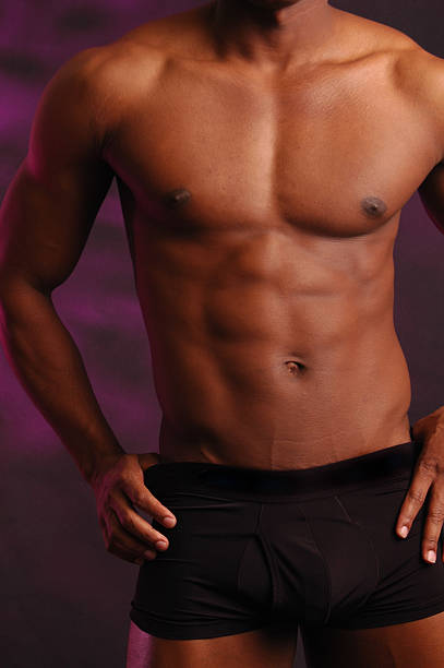 male torso on purple stock photo