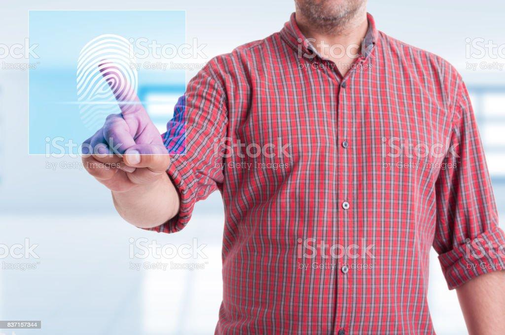 Male touching modern button for fingerprint scan stock photo