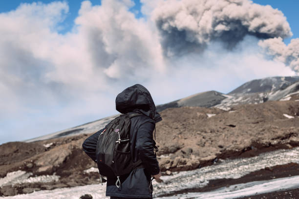 Male tourist enjoying the view of active Mount Etna stock photo