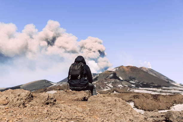 Male tourist enjoying the view of Mount Etna stock photo