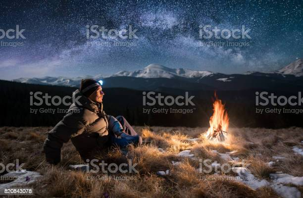 Male tourist have a rest in the mountains at night guy with a near picture id820843078?b=1&k=6&m=820843078&s=612x612&h=rs4canlqzn2fwjvrn2jkct1eehcnyugoqlmrlikxnqc=