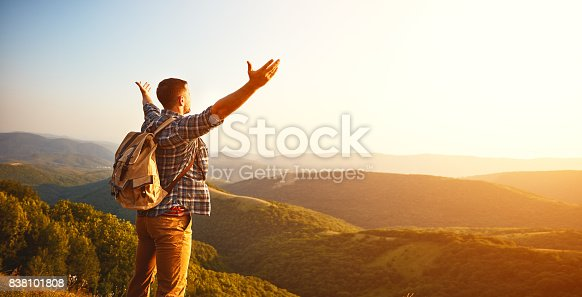 istock Male tourist on top of mountain in fog in autumn 838101808