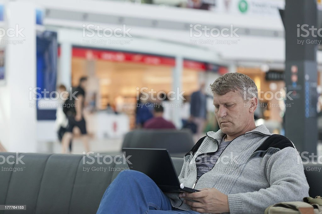 male traveler with the laptop uses a Wi-Fi royalty-free stock photo