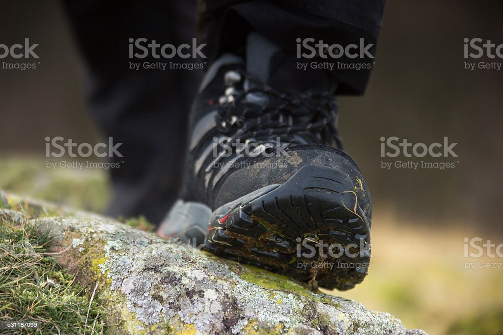 Male Trekking Boots On a Rock stock photo