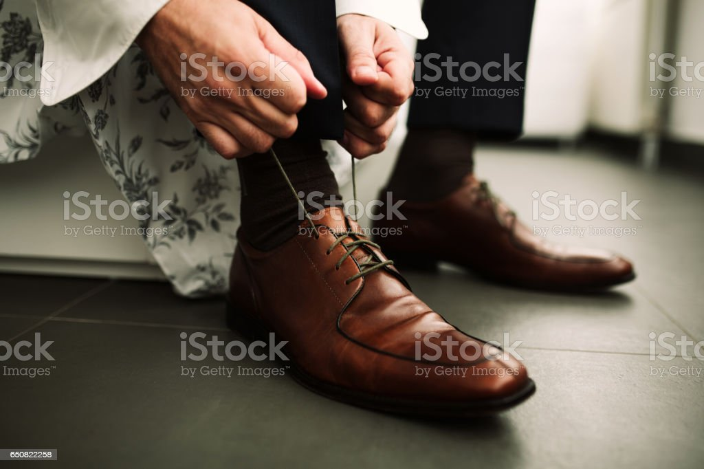 Male tying his shoes stock photo
