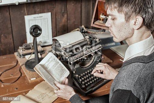 Male Typist on an Antique Typewriter.