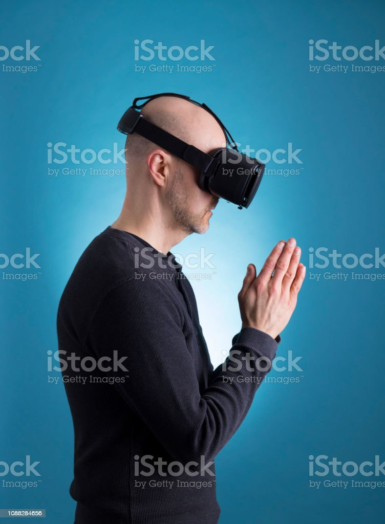 Male using VR Virtual Reality headset stock photo