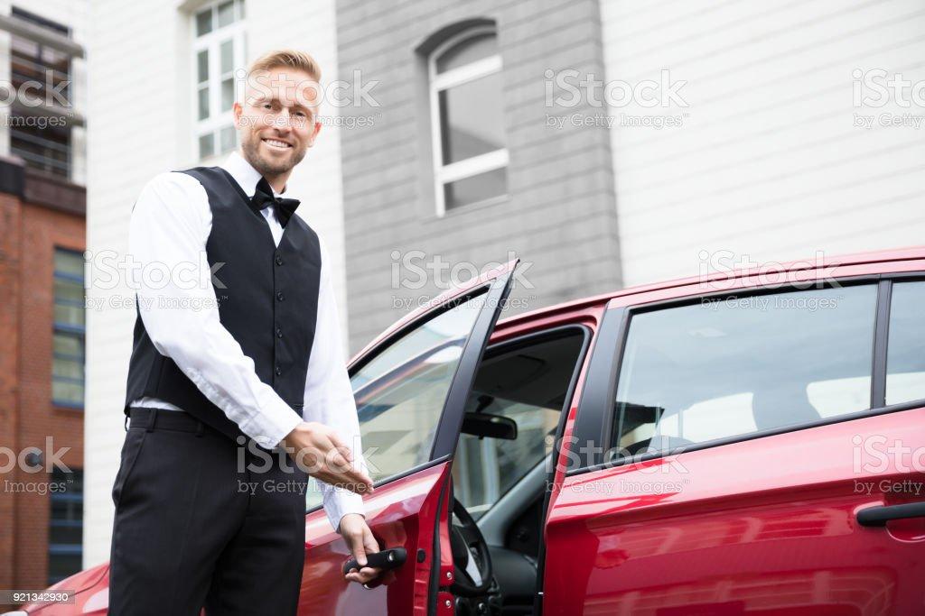 Male Valet Opening Car Door stock photo