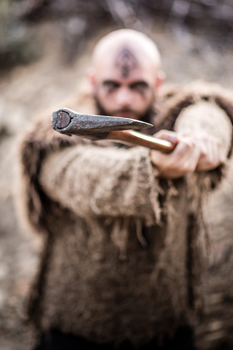 Male Viking Swinging Axe Stock Photo - Download Image Now