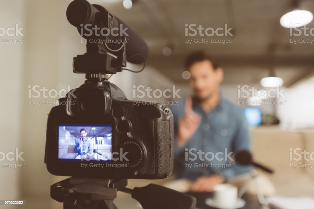 Male vlogger recording content for his vlog stock photo