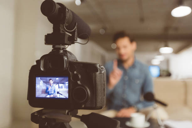 male vlogger recording content for his vlog - home video camera stock photos and pictures