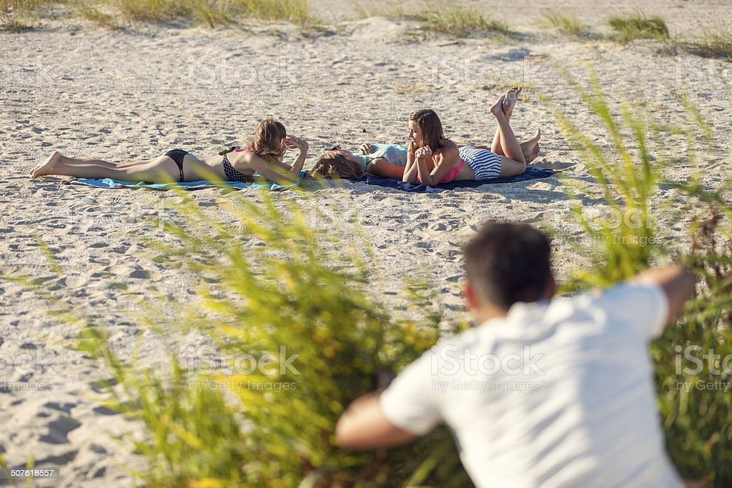Male Voyeur On Beach stock photo