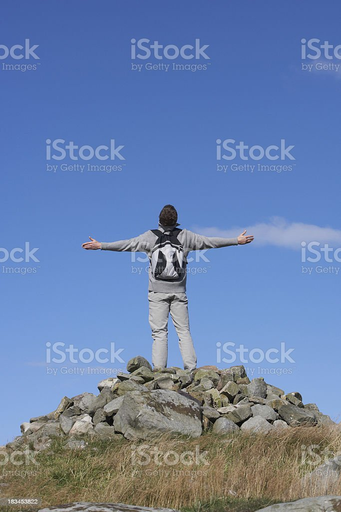 Male Walker Standing On Pile Of Rocks royalty-free stock photo