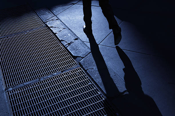 Male walking in blue night shadows  creepy stalker stock pictures, royalty-free photos & images