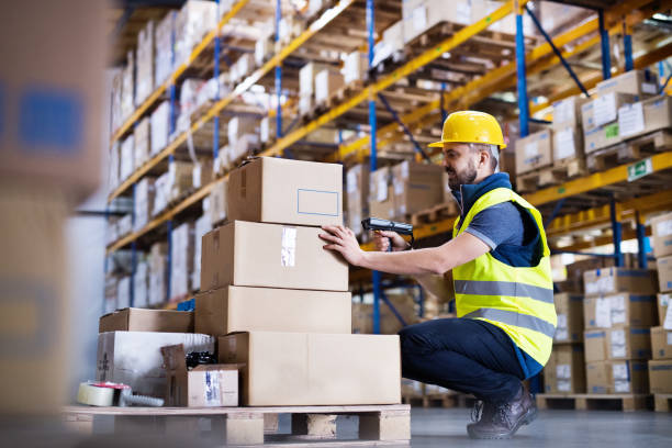 Male warehouse worker with barcode scanner. stock photo