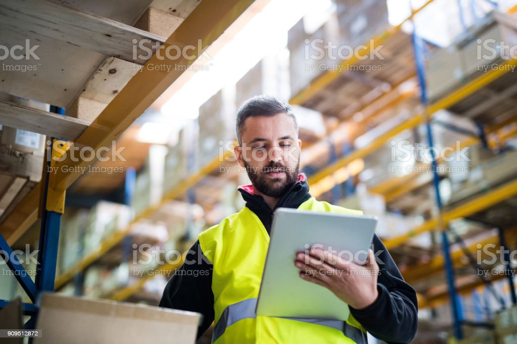Male warehouse worker with tablet. stock photo