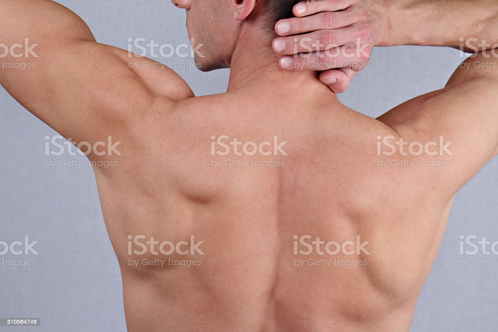 Male Waxing. Muscular male body hair removal close up. stock photo