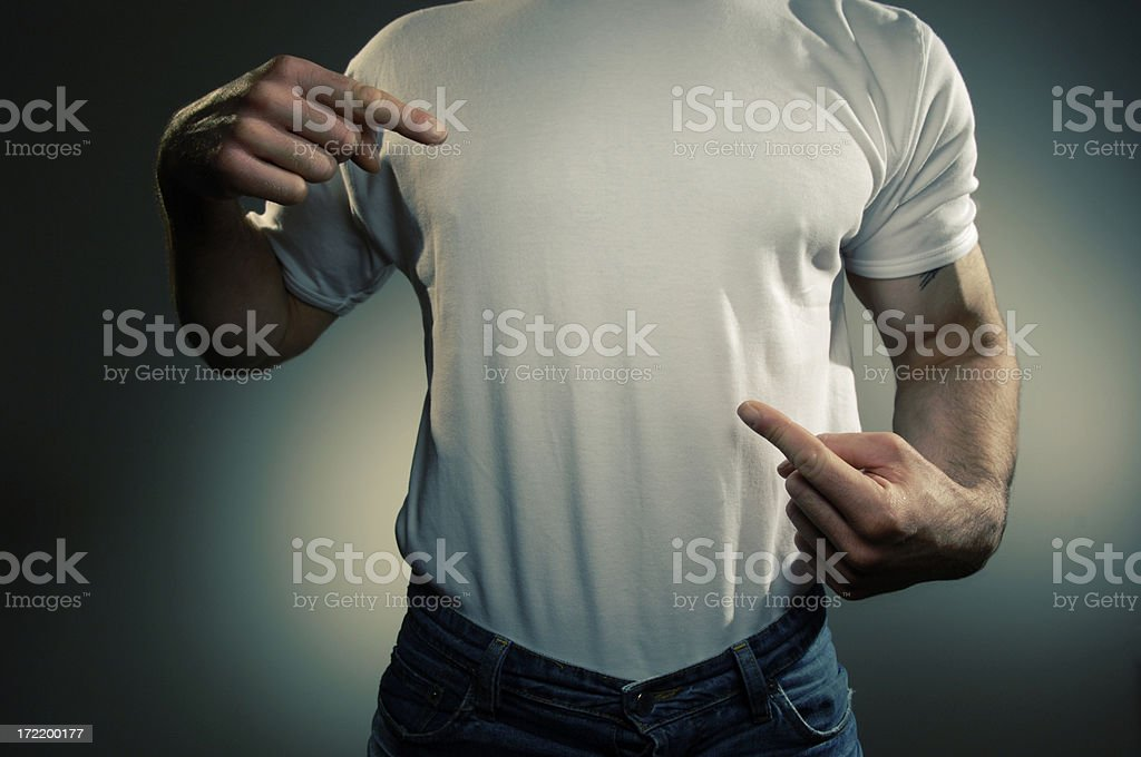 Male wearing a white T shirt and pointing to his chest stock photo