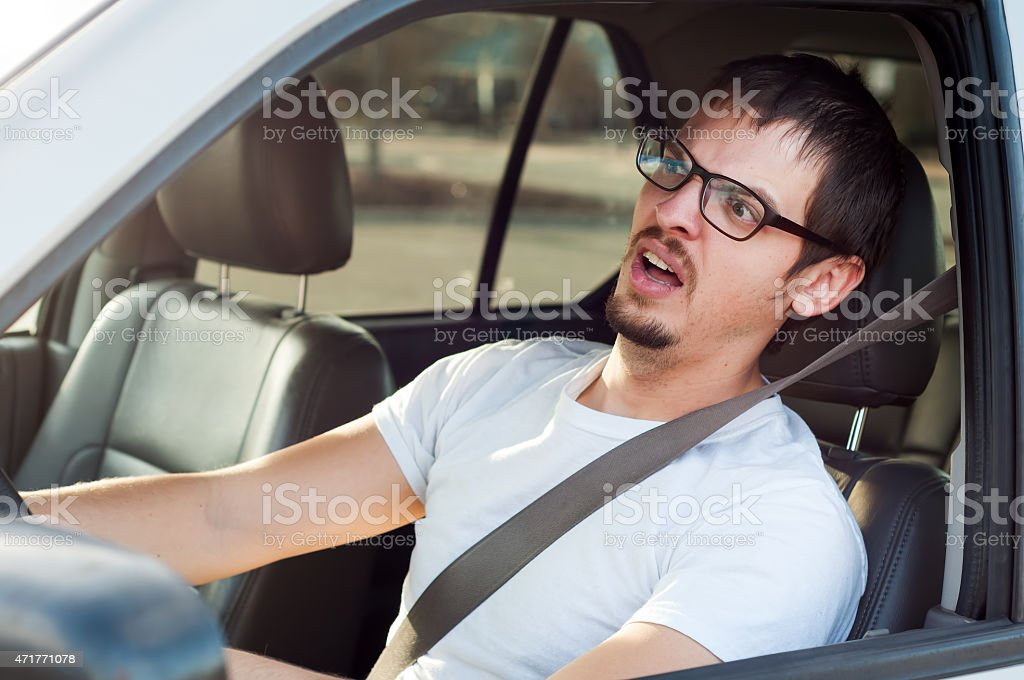 Male white driver is scared in traffic accident stock photo