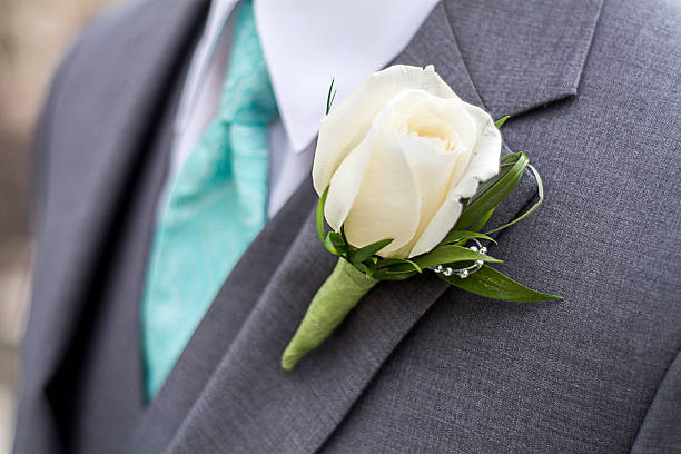 male with grey suit and rose boutonniere - prom stock photos and pictures