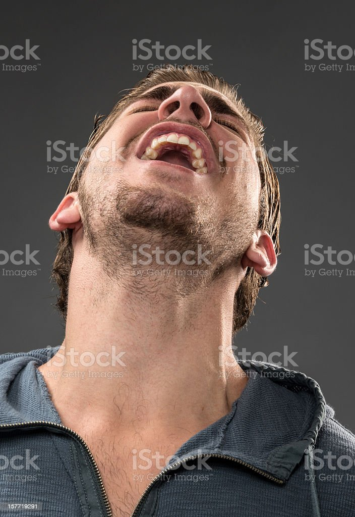 Male with head back screaming or laughing. stock photo