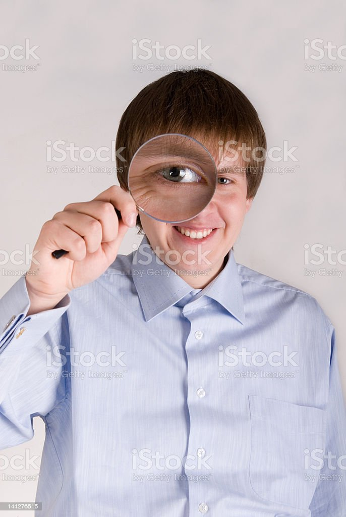 Male with magnifying glass royalty-free stock photo